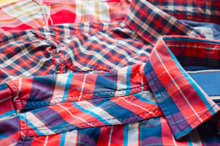 Close up of three red, colorful shirts