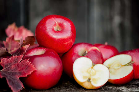 organic fresh apples on wooden background in autumn harvest at local farm. Agriculture concept theme with fresh apples in nature