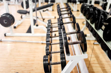 dumbbells in modern sports club, gym or fitness center  Weight Training Equipment