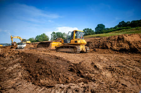 Photo for industrial machinery at working construction building site  Excavator, dumper truck and bulldozer working on ground - Royalty Free Image