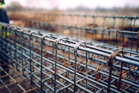 Foto de rebar steel bars, reinforcement concrete bars with wire rod used in foundation of construction site - Imagen libre de derechos