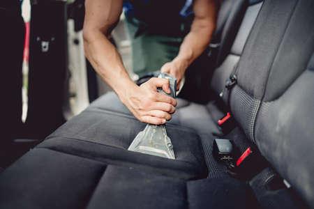 Photo pour Close up details of car detailing - Cleaning and vacuuming car interior - image libre de droit