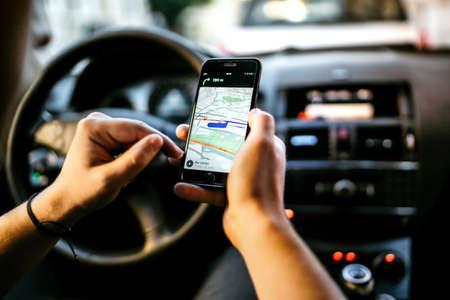Photo pour GPS and online Map to Route Destination. Man using network connection for gps tracking - image libre de droit