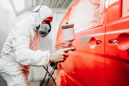 Photo for Close up details of mechanic worker, painting a red car - Royalty Free Image