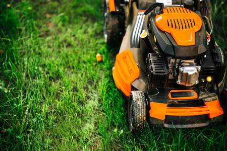 Foto für Garden and grass maintainance details - close up view of grass mower, lawnmower details - Lizenzfreies Bild