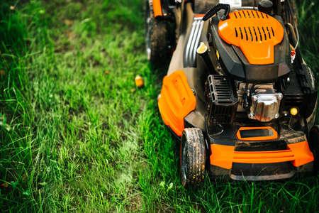 Foto de Garden and grass maintainance details - close up view of grass mower, lawnmower details - Imagen libre de derechos