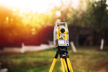 Photo for surveyor engineering equipment with theodolite and total station in a garden - Royalty Free Image