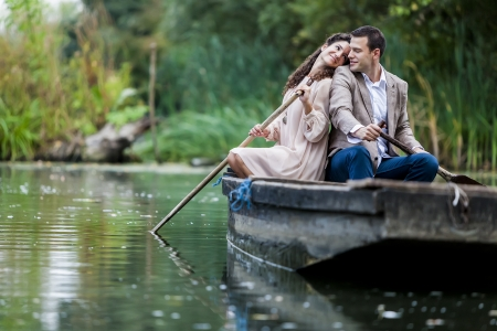 Loving couple at the calm lake