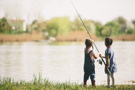 Two little girls fishing