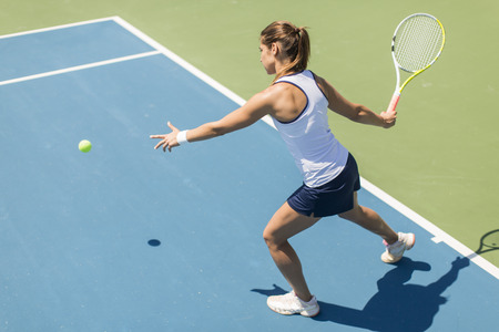 Photo for Young woman playing tennis - Royalty Free Image
