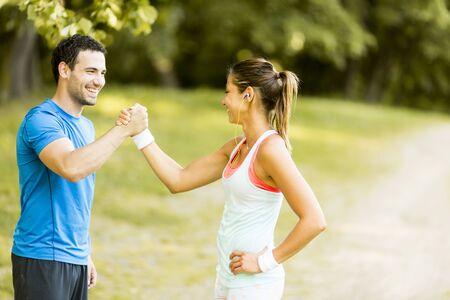 Photo pour Woman training with personal trainer outdoor - image libre de droit