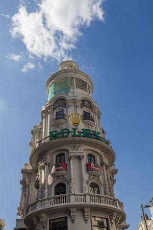 MADRID, SPAIN - MARCH 16, 2016: Exterior of the Edificio Grassy building in Madrid. It was built between 1916 and 1917. In 1981, the Edificio Grassy was immortalized by painter Antonio López in his hyperrealist masterpiece La Gran Vía.