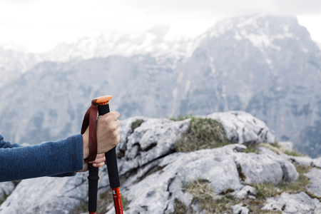 Closeup of the female holding walking sticks on mountain trecking