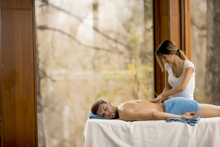 Young man having relax massage in the spa