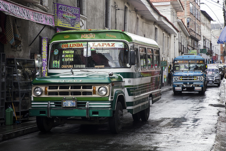 LA PAZ, BOLIVIA - JANUARY 12, 2018: Buses at street of La Paz, Bolivia. At an elevation of 3650 m La Paz is the highest capital city in the world