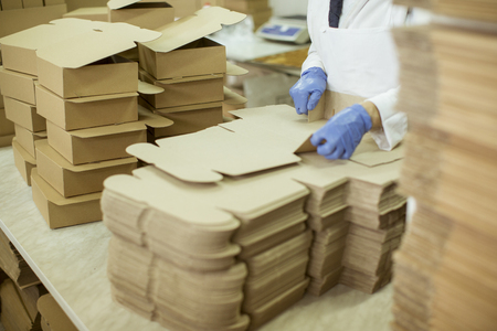 Photo for Person at work in a cookies factory - Royalty Free Image