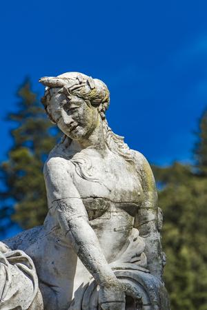 Detail of the beautiful fountain in the Jardin de la fontaine in Nimes, France