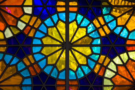 Photo pour Closeup detail of the colorful stained glass window - image libre de droit