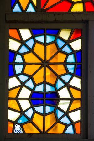 Foto de Closeup detail of the colorful stained glass window - Imagen libre de derechos