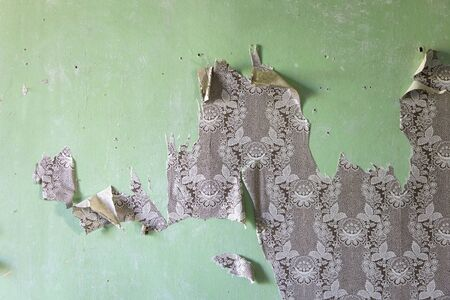 Photo for Detail of the torn wallpapers on the old green wall - Royalty Free Image