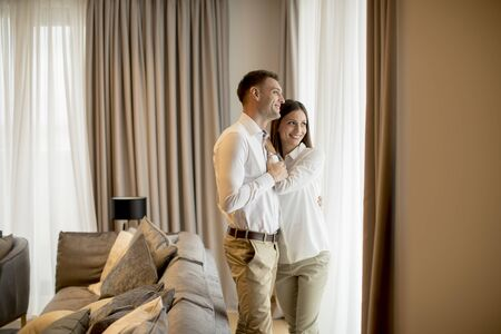 Photo pour Romantic happy young couple relax at the modern home interior - image libre de droit