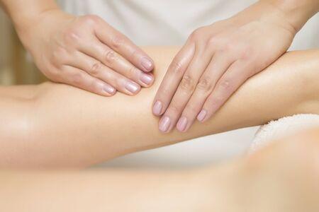 Photo pour Woman getting leg massage in the spa center - image libre de droit