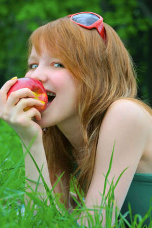 beautiful girl with apple outdoor