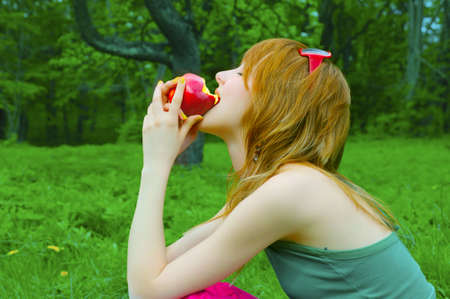 pretty girl nibble juicy apple