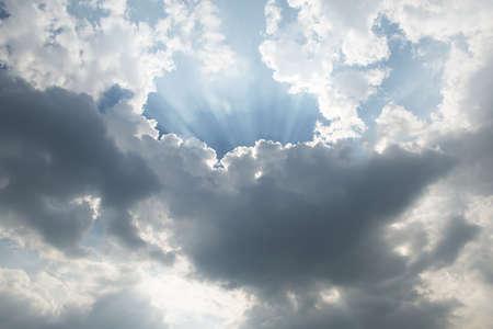Sunlight rays in dark cloud