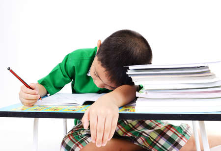 Student boy sleep while doing homework