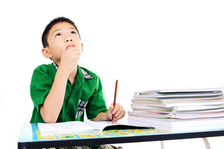 Student boy thinking about the answer on homework