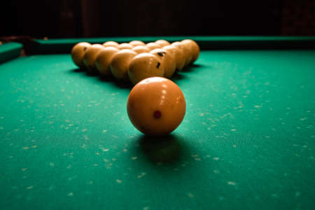 Photo for pyramid of billiard balls on the billiard table close up. Billiard balls pool in triangle on green table - Royalty Free Image