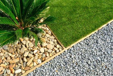 Photo pour Landscaping combinations of grass, plant and stones - image libre de droit
