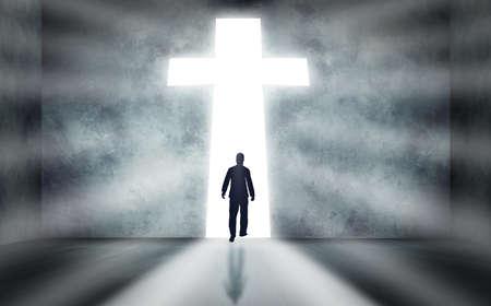 Photo pour Man walking towards a huge cross passage - image libre de droit