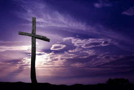 Silhouette of cross over purple sunrise or sunset