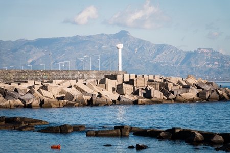 Port of Riposto with lighthouse and rocks protection