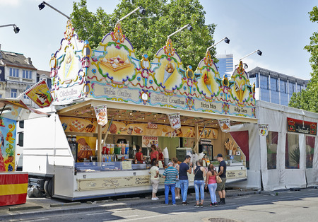 BRUSSELS, BELGIUM - JULY 27, 2014: Food stall selling the famous Belgian chips in the biggest fun fair in Brussels on 20 july, 2014.People make queue and wait for their turn.