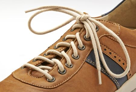Photo pour Shoelace in close up and brown shoe isolated on white - image libre de droit