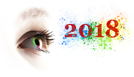 Photo pour Colorful rainbow female eye and colored 2018 splashing over white - image libre de droit