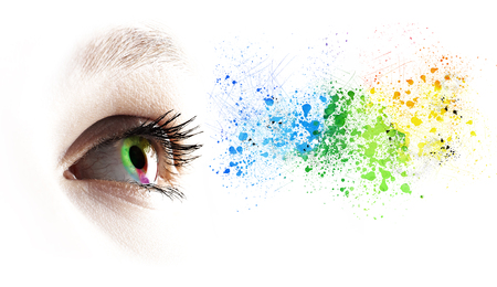 Foto de Colorful rainbow female eye and colored splashing over white - Imagen libre de derechos