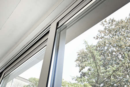 Photo for Sliding glass door and his ventilation system, before painting the wall - Royalty Free Image