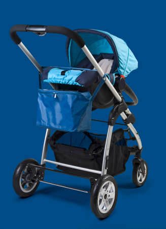 Photo pour Take a walk with baby buggy isolated on blue classic - image libre de droit