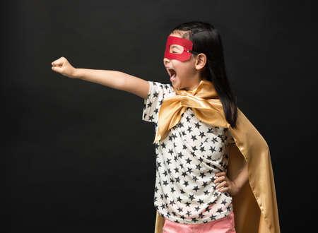 Photo for Superhero kids on a black background - Royalty Free Image