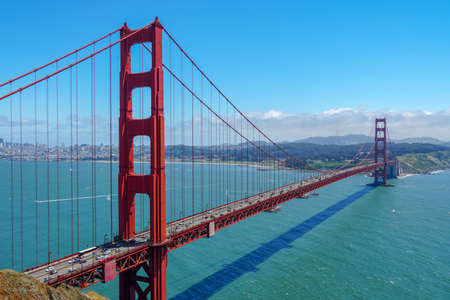 Photo for Golden Gate Bridge, suspension bridge. The structure links the American city of San Francisco, California, the northern tip of the San Francisco Peninsula to Marin County, USA. July 13th, 2020 - Royalty Free Image