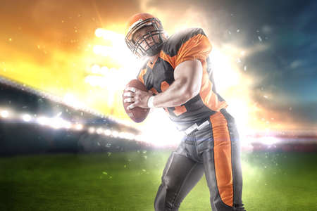 Photo for American football player at the stadium in black and orange outfit. - Royalty Free Image