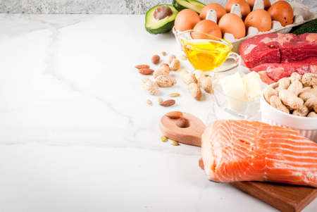 Foto de Ketogenic low carbs diet concept. Healthy balanced food with high content of healthy fats. Diet for the heart and blood vessels. Organic food ingredients, whiite marble background, copy space - Imagen libre de derechos