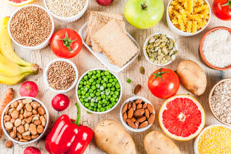 Photo for Diet food background concept, healthy carbohydrates (carbs) products - fruits, vegetables, cereals, nuts, beans, light concrete background above - Royalty Free Image