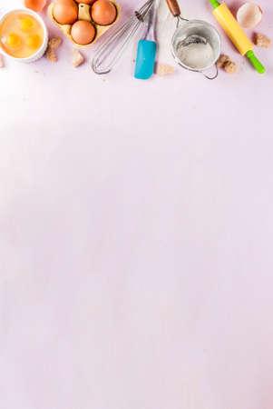 Foto de Ingredients and utensils for cooking baking egg, flour, sugar, whisk, rolling pin, on light pink background, copy space top view - Imagen libre de derechos