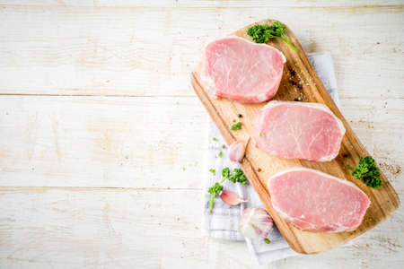 Photo for Cooking meat dinner background. Raw fresh meat, pork brisket boneless steak, with spices, herbs, olive oil, on a white wooden background, top view - Royalty Free Image