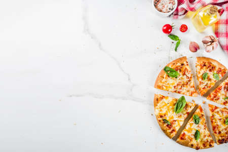 Photo pour Homemade sliced cheesy classic italian pizza with ingredients and olive oil, white marble background copy space top view - image libre de droit